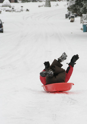 Kellen sledding down 43rd St